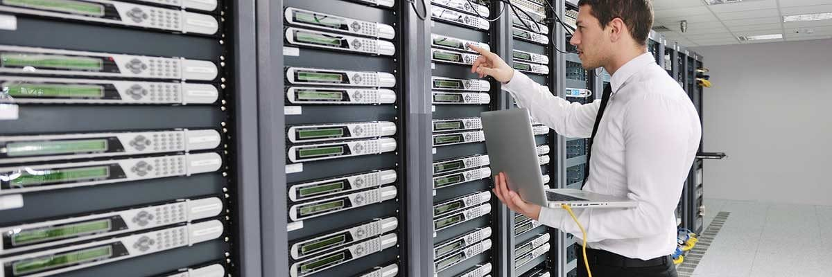 A technician working with a collection of servers. IT services Akron Ohio.