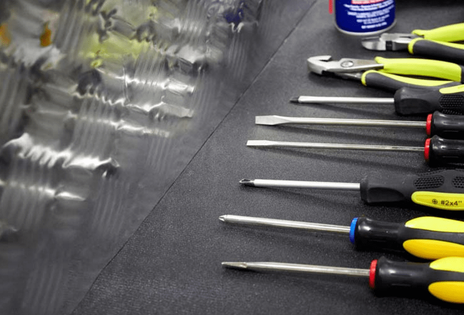 Some screwdrivers stored with Zerust's tool box liner.