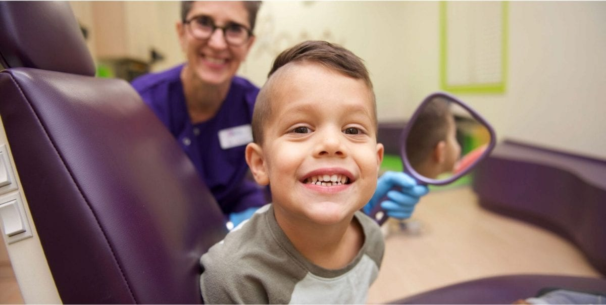 Dr. Laura Adelman, children's dentist near me, and her patient.