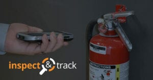 fire extinguisher barcode inspection user with mobile device inspecting extinguisher