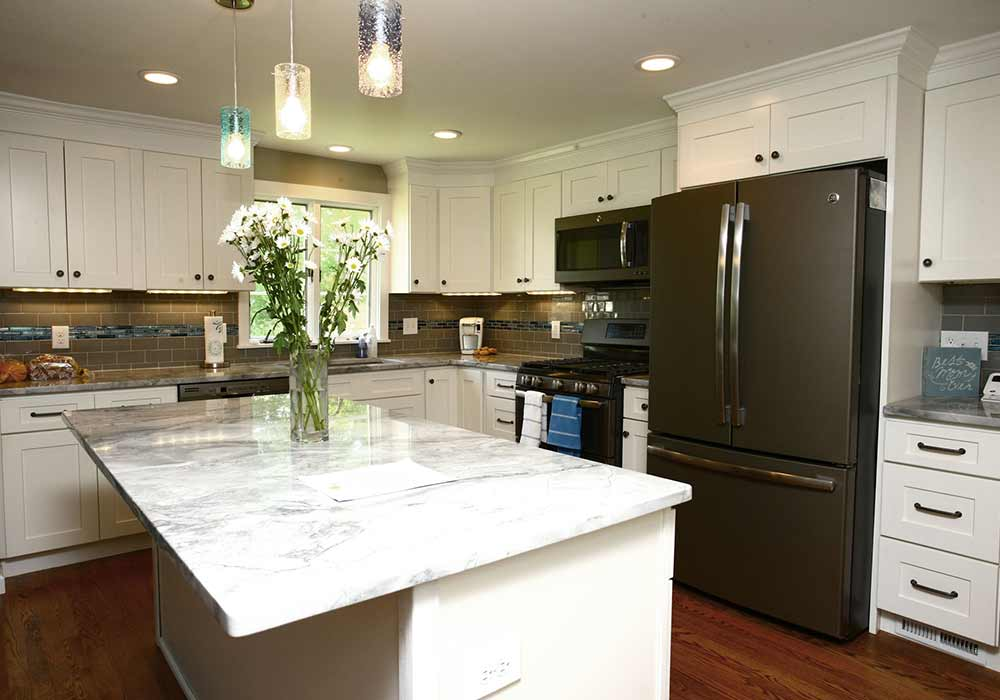 A home kitchen with marble countertops and several appliances | HVAC zoning